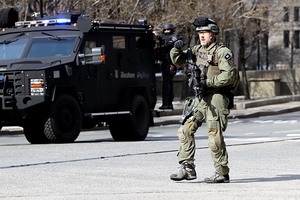 Boston, MA, April 15, 2013:  A Boston SWAT team member walks near the perimeter of Copley Square after two explosions were detonated at the finish line of the 2013 Boston Marathon.  (Photo b ...