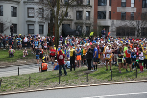 Boston, Mass. April 15- Runners were corralled by race officials and police officers at the 25 mile marker of the Boston Marathon.  The race was stopped due to explosions at the finish line. ...